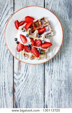 waffles with fresh berries and cream