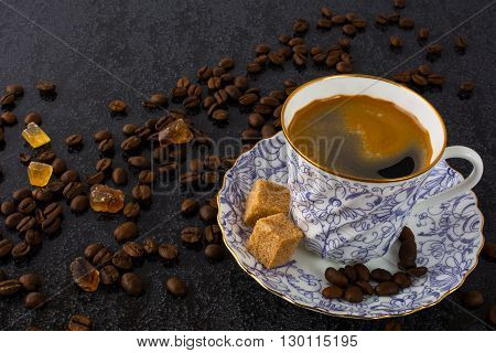China cup of coffee on black background. Coffee cup. Cup of coffee. Strong coffee. Morning coffee. Coffee mug. Strong coffee. Coffee break.