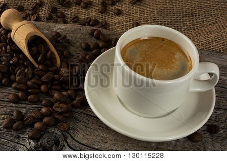 Coffee mug on the wooden background. Strong coffee. Morning coffee. Coffee break. Strong coffee. Coffee cup. Cup of coffee. Coffee mug.
