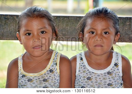 RURAL GUATEMALA MAY 05 2016: Portrait of a Mayan twin girl. The Mayan people still make up a majority of the population in Guatemala,