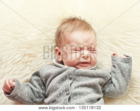 little baby crying on classic white fur