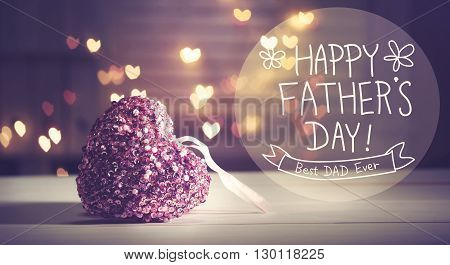 Happy Fathers Day message with pink heart with heart shaped lights