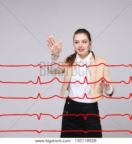 Doctor woman working with cardiogram lines