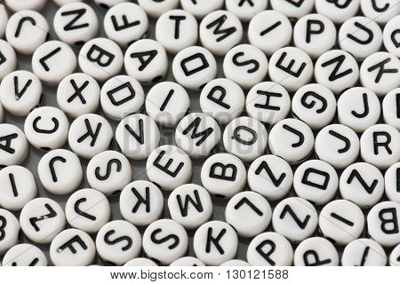 Encryption. Letters of the alphabet randomly placed.  Shallow depth of field.