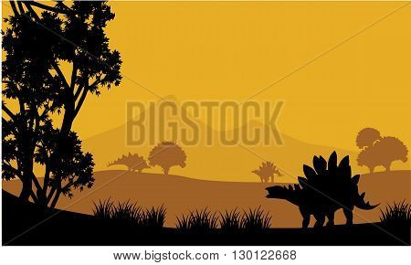 Landscape of stegosaurus silhouette at the afternoon