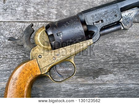 Close up of a western six shooter pistol.