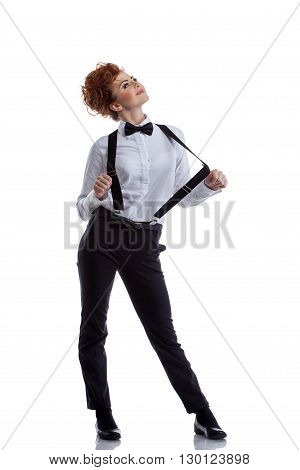 Flirtatious dancer dressed in formal suit. Isolated on white