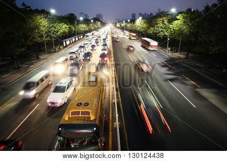 Noisy big highway. Traffic jam. Nightlife and city in lights.