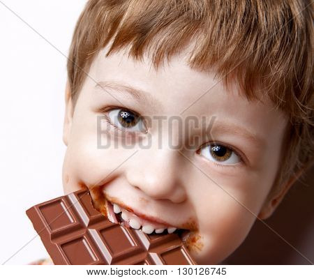 happy boy with chocolate bar