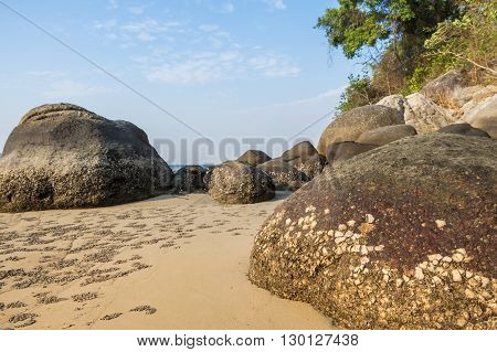 Landscape with beautiful beach against seaview with rocks and a cloudy sky at kata beach, Phuket, Thailand