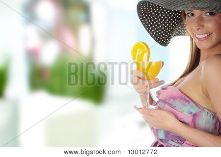 Photo of beautiful woman holding a orange cocktail