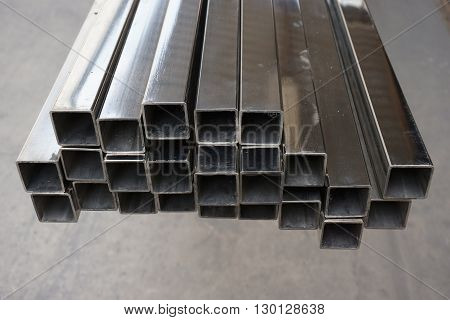 stack of square stainless steel tube in warehouse