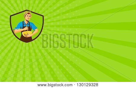 Business card showing illustration of a female chef with bandana holding spatula and mixing bowl mixing viewed from the front set inside shield crest on isolated background done in retro style.