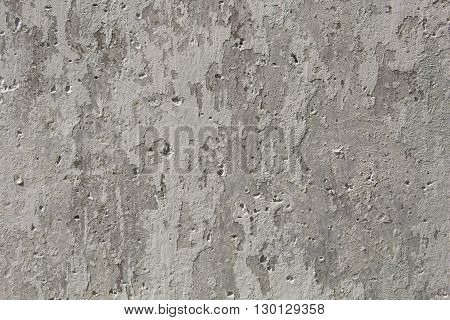 The damaged gray surface from concrete with poles from bubbles and spots