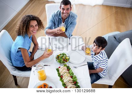 Portrait of family having breakfast together at home