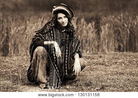 Young fashion rasta woman walking outdoor