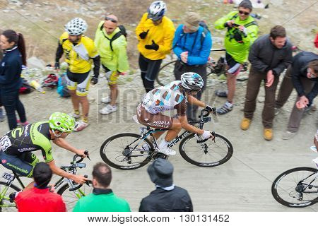 Tour Of Italy: Cyclist Racing On Mountain Dirt Road
