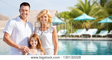 summer holidays, travel, tourism, vacation and people concept - happy family over hotel resort swimming pool and sun beds background