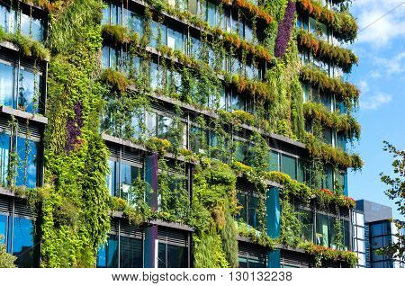 Eco architecture. Green skyscraper with hydroponic plants on the facade. Ecology and green living in city urban environment concept. Park in the sky One central park building Sydney Australia