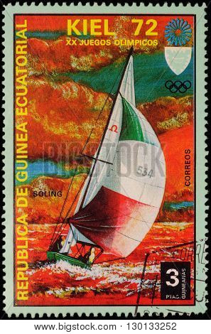 MOSCOW RUSSIA - APRIL 27 2016: A stamp printed in Equatorial Guinea shows yachting the race in Soling class series
