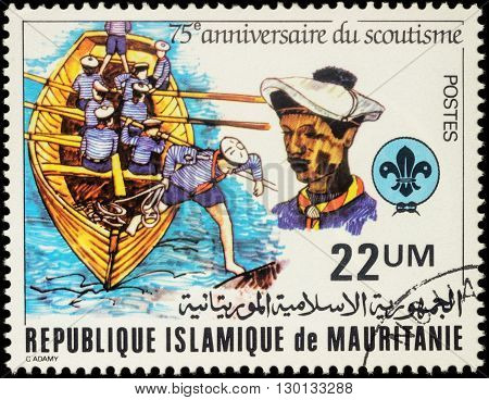 MOSCOW RUSSIA - MAY 14 2016: A stamp printed in Mauritania shows rowing boat with scouts series