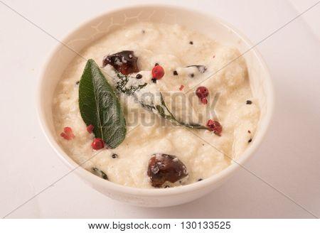 bowl of indian Coconut Chutney isolated on white background