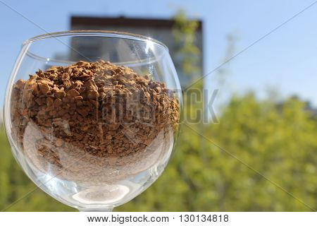 wine glass with granulated coffee left dackground