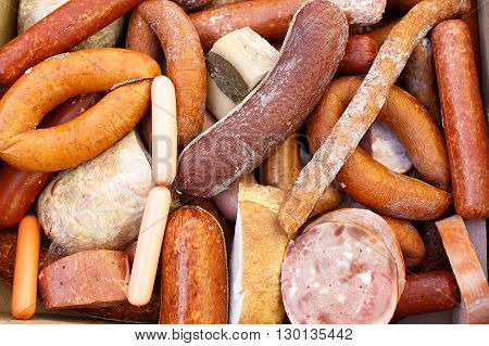 tainted meat products. stale frankfurter and sausages. a lot of sausages with mold. top view