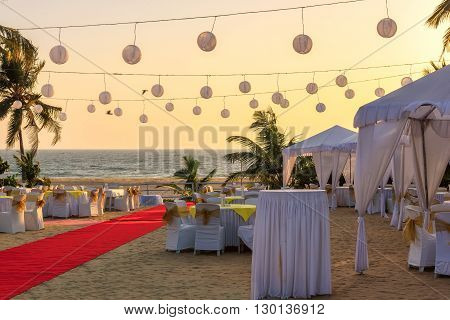 Outdoor restaurant at the beach during at sunset, GOA, India