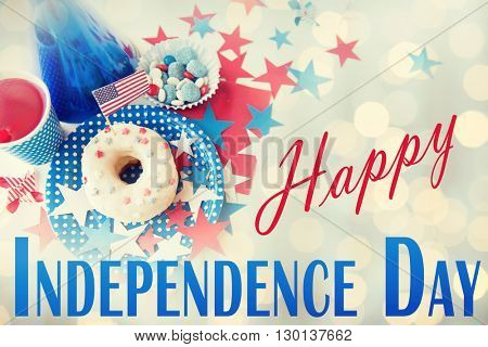 happy american independence day, celebration, patriotism and holidays concept - close up of donut with juice drink and candies in disposable tableware at 4th july party from top