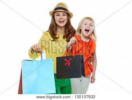 Portrait Of Happy Mother And Daughter Showing Shopping Bags