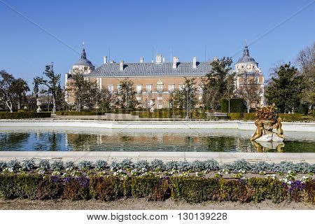 Aranjuez Spain - March 13 2016: View at the fountain in garden of Royal Palace of Aranjuez. The Royal Palace of Aranjuez is a residence of the King of Spain located in the town of Aranjuez.