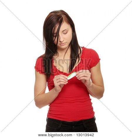Sad woman with pregnancy test, over white background