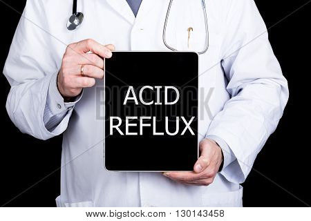 technology, internet and networking in medicine concept - Doctor holding a tablet pc with acid reflux sign. Internet technologies in medicine.