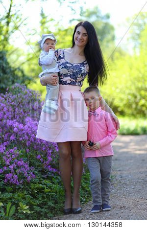young mother with boys in park