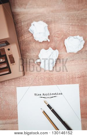 Visa application message on a white background against view of an old typewriter and paper