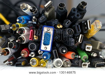 Bunch of great number of different colored cables with various connectors for various devices