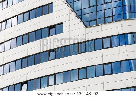Abstract modern architecture. Modern building of steel and glass. Close-up of industrial building.