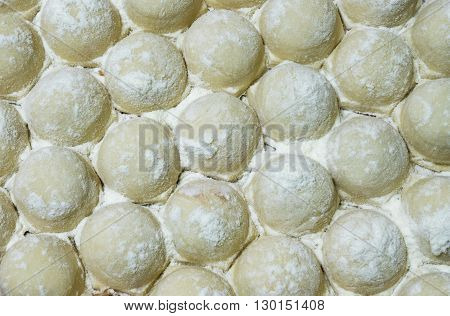 Russian pelmeni close up background sprinkled with flour.