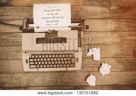 Keep youy eyes on the sun and you will not see the shadows message against view of an old typewriter and paper