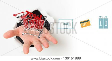 Digital shopping online diagram on a white background against composite image of open hand bursting through paper