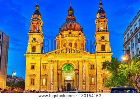 BUDAPEST, HUNGARY-MAY 05 , 2016:St.Stephen Basilica in Budapest at nightime people on square near Basilica.