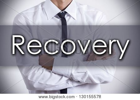 Recovery - Young Businessman With Text - Business Concept
