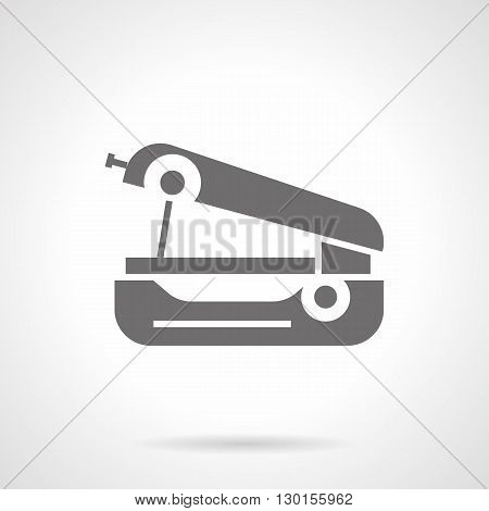 Small portable sewing machine. Equipment for sewing and clothes repair, mending. Mechanical sewing tool. Symbolic black glyph style vector icon.