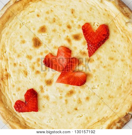 Tasty cheesecake with strawberry hearts. Sweet food. Vibrant colors. Delicate cheesecake.