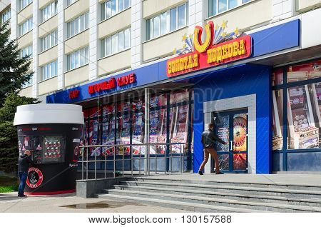 GOMEL BELARUS - APRIL 23 2016: Unknown young man enters into gaming club