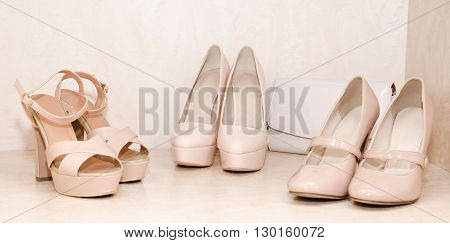 Women's shoes and clutch in the wardrobe