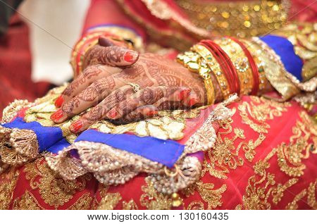 A Bride's Hands with Henna Tattoos at Wedding
