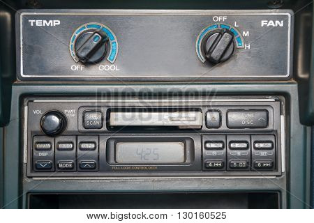 an old-fashion cassette tape player in car