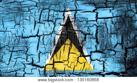 Flag of Saint Lucia painted on cracked ground